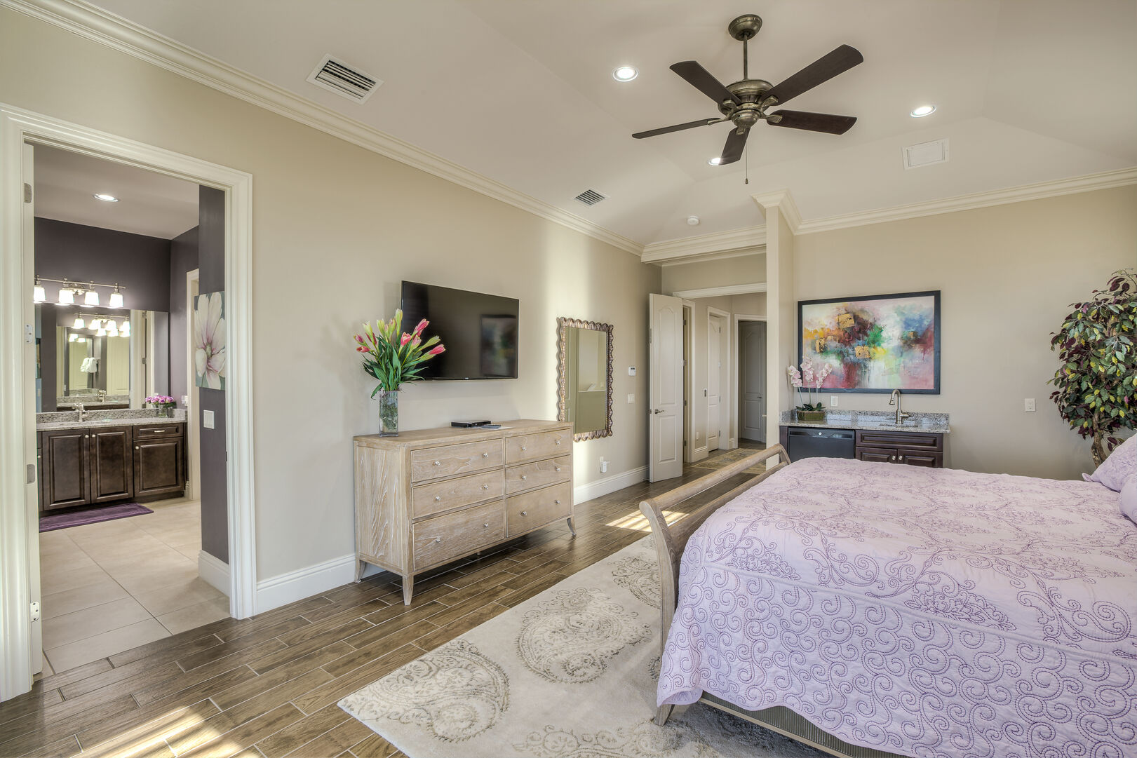 Master bedroom with ensuite bathroom in our Fort Myers vacation home rental