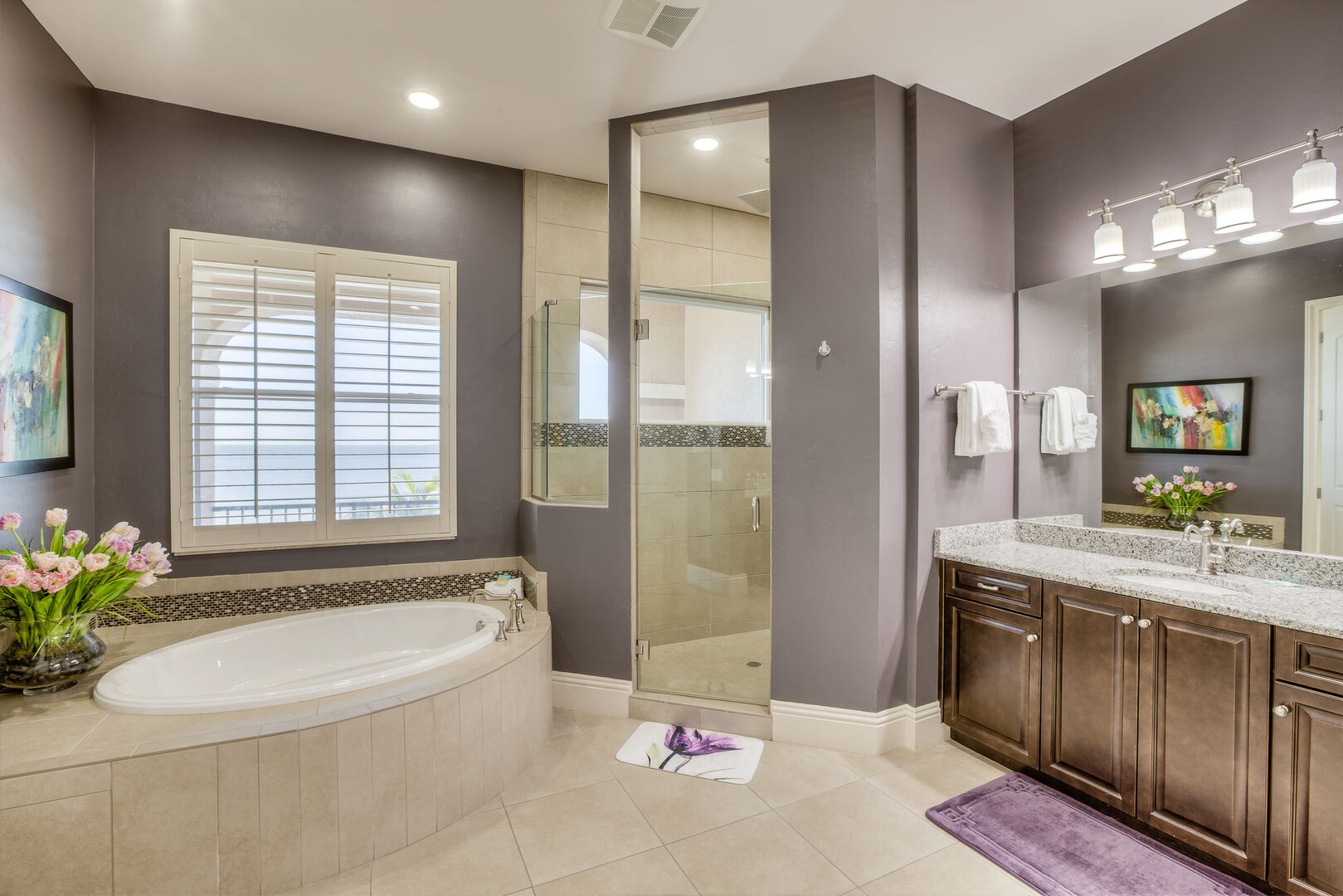 Master bathroom with tub and shower in our Fort Myers vacation home rental