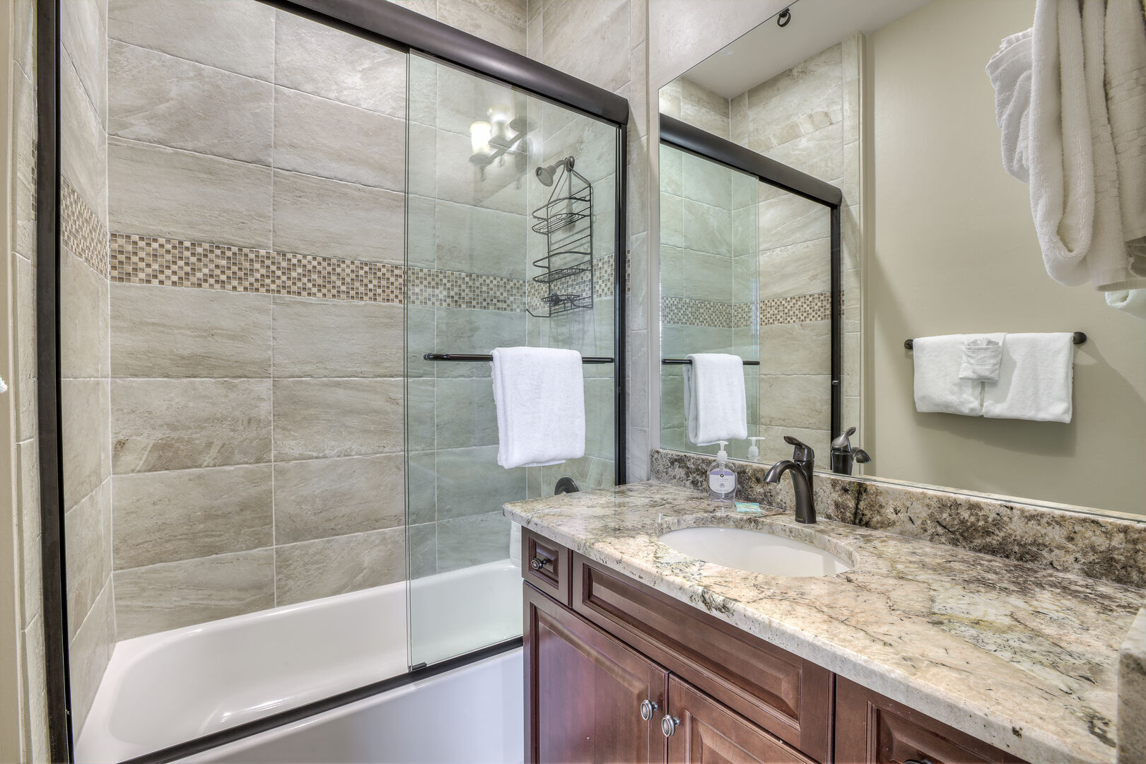 Guest bathroom with shower/tub combo in our Fort Myers vacation home rental