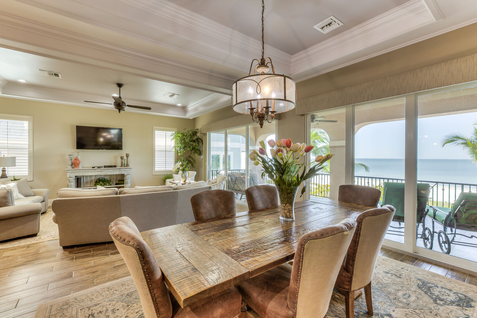 Dining room with view into living room and balcony in our Fort Myers vacation home rental