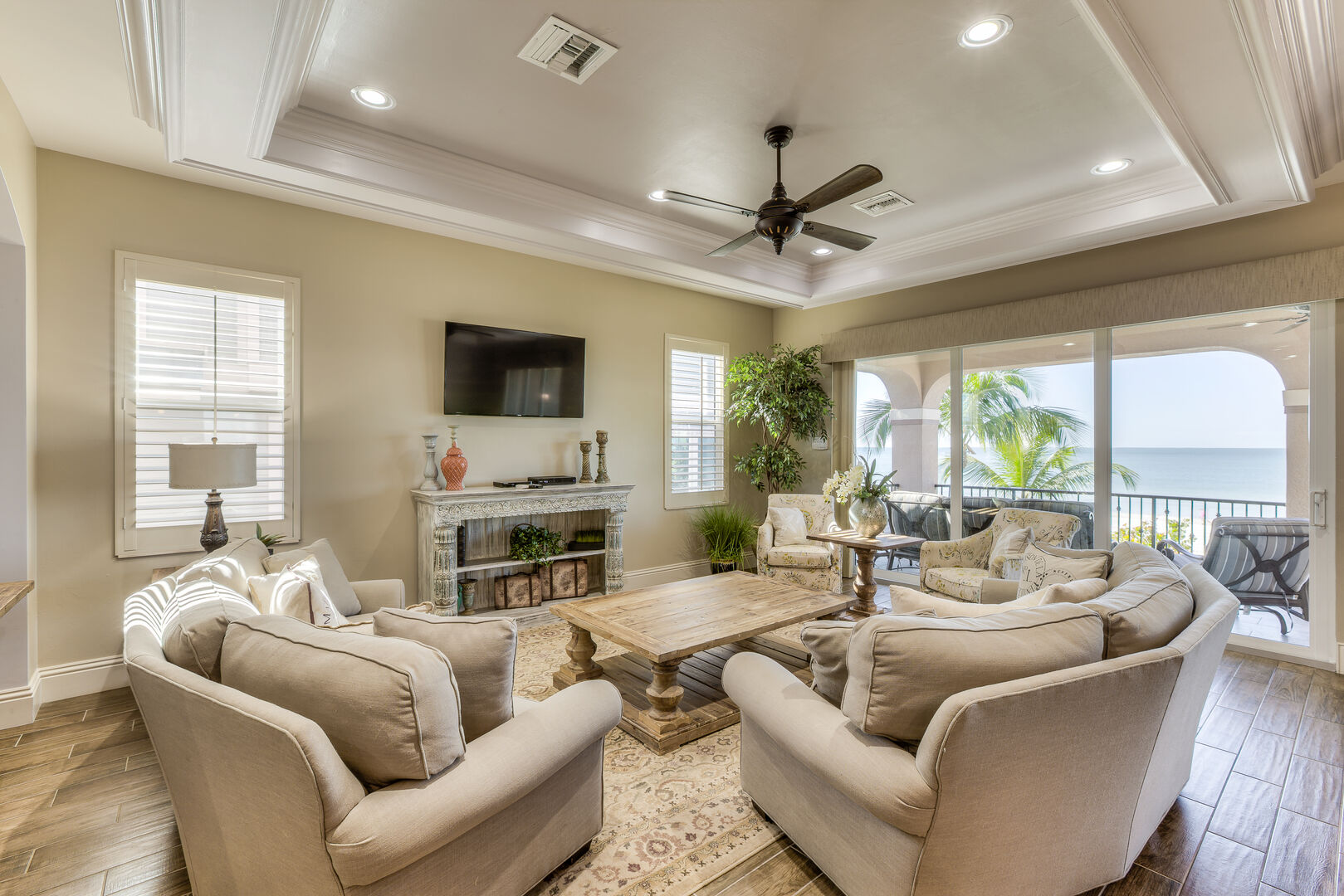 Living area with couches and TV in our Fort Myers vacation home rental