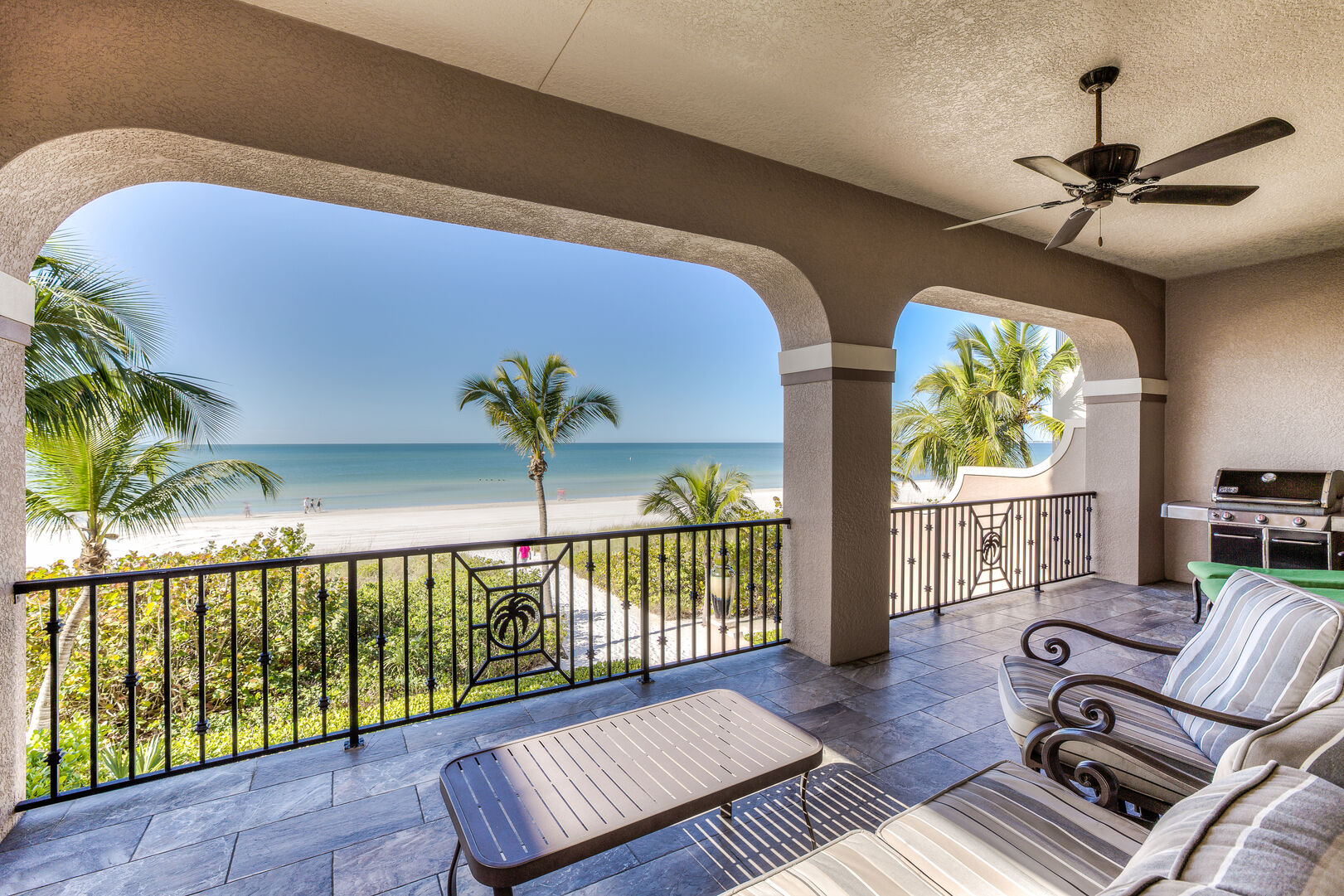 Balcony with seating and grill in our Fort Myers vacation home rental
