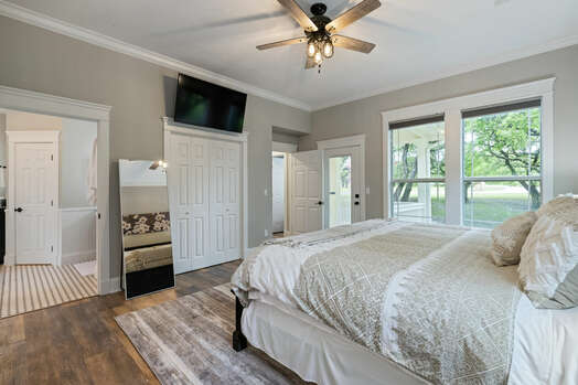 Main level master bedroom with a king bed and 55