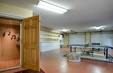 Converted garage into a game room with ping pong & foosball. Enjoy elevator access too.