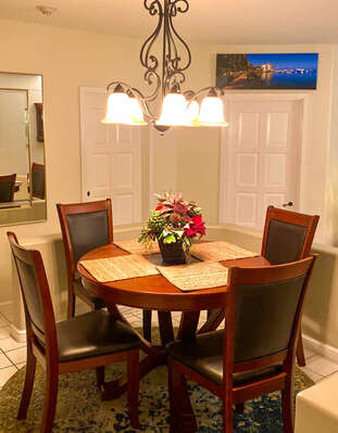Entrance to condo, dining seating for 4 with overhead lighting