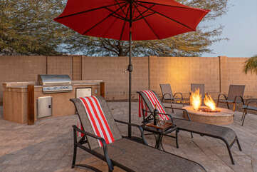 Backyard amenities include a built in gas grill and gas fire pit.