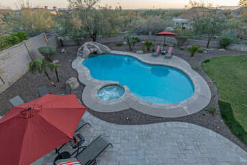 Play on the fun slide in the lagoon pool with optional heat or enjoy tranquil soaks in the inground hot tub.