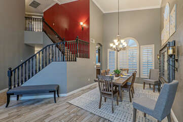 Front entrance staircase leads to 3 upstairs bedrooms and 2 bathrooms.