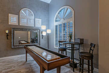 A game room with shuffleboard provides indoor fun and friendly competition for guests.