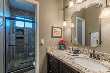 Bathroom 2 with a walk-in shower is upstairs and shared by Bedrooms 2 and 3.