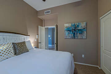 Bedroom 4 is on the ground floor, features a king bed and TV, and shares Bathroom 3 with visitors.