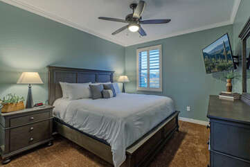 Bedroom 2 is upstairs and has a king bed, ceiling fan and TV.