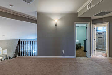 The upstairs landing connects 3 bedrooms and 2 bathrooms.