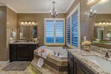 The primary bath on the second floor has a separate garden tub, new walk-in shower plus dual vanities and sinks.
