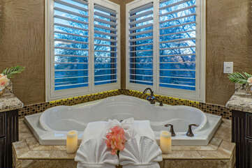 Imagine the divine and luxurious soaks you will enjoy in the primary suite's garden tub.