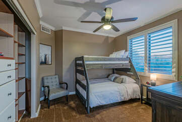 The primary suite has an alcove with a bunk set. The bottom is full bed size and the top is a twin.