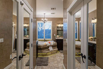Make yourself at home and move your accessories and wardrobe into spacious closets adjacent to the primary bath.