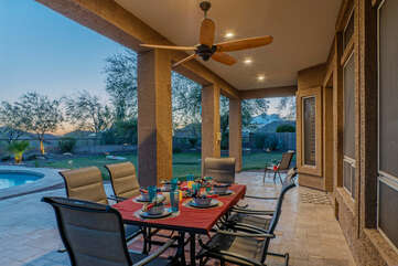 The large covered patio with ceiling fans is perfect for relaxing and outdoor dining.