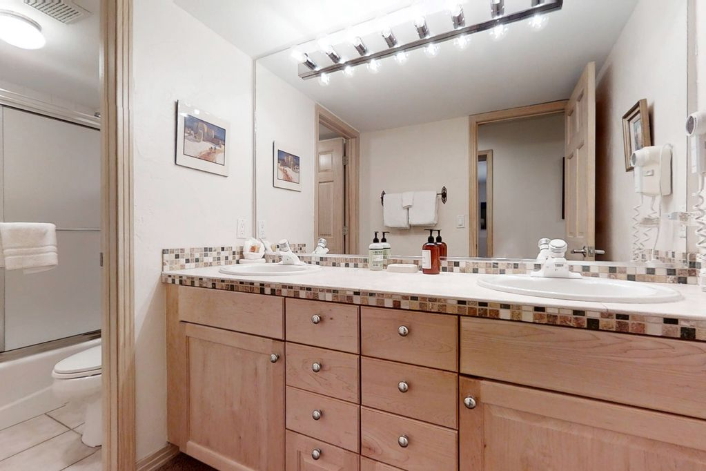 Lower level bathroom with double vanities.