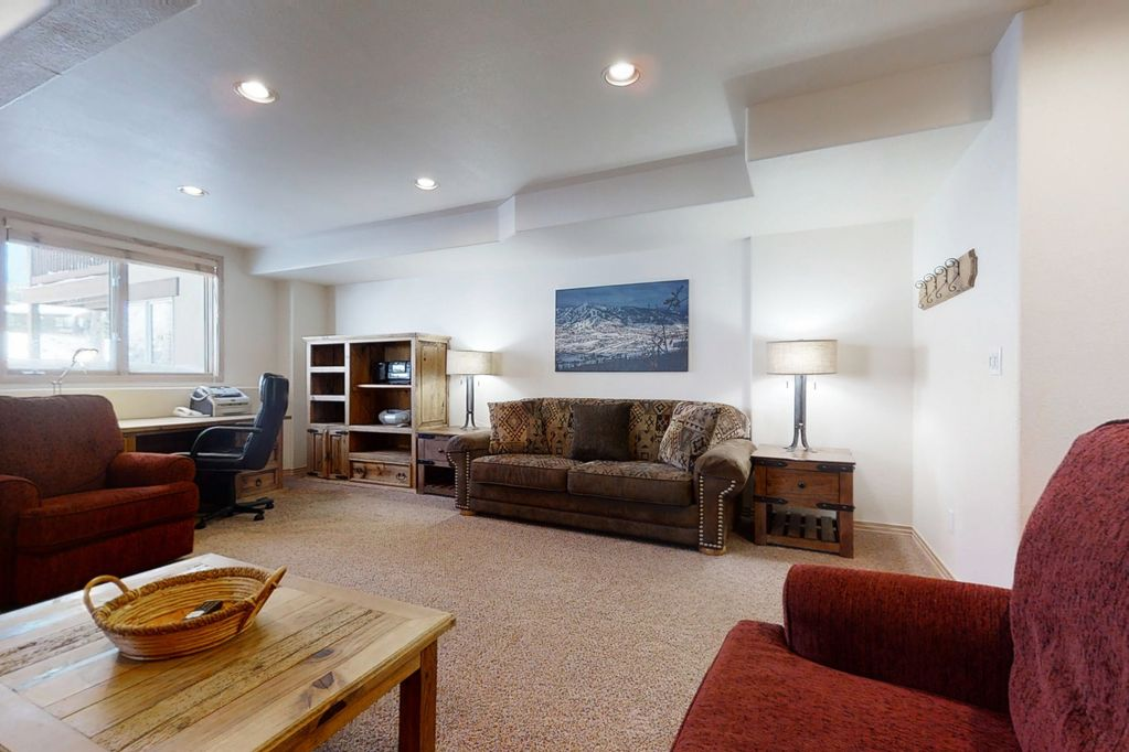 Second living area located downstairs with desk and plenty of room to pull out the queen sofa sleeper!