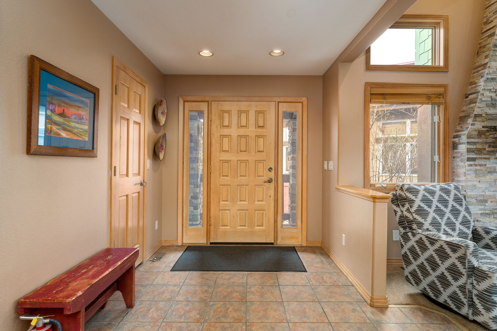 Open foyer with coat/gear closet and bench to help you get ready for the day!