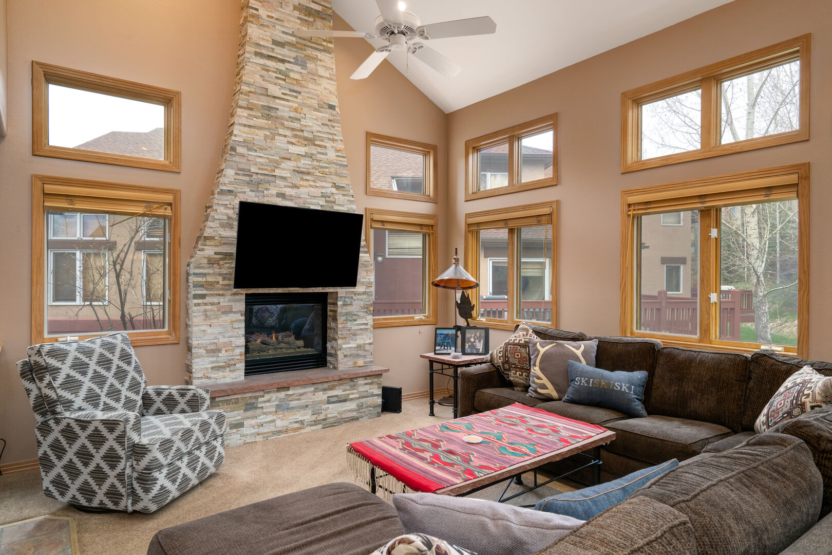 Spacious and comfortable living room with gas fireplace and large flat screen television