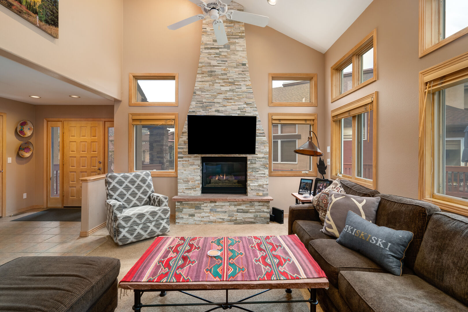 Gorgeous stacked stone fireplace to warm up on chilly nights!