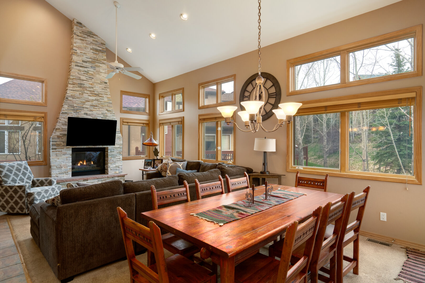 The living room and large dining table with room for 8. Tons of natural light!!