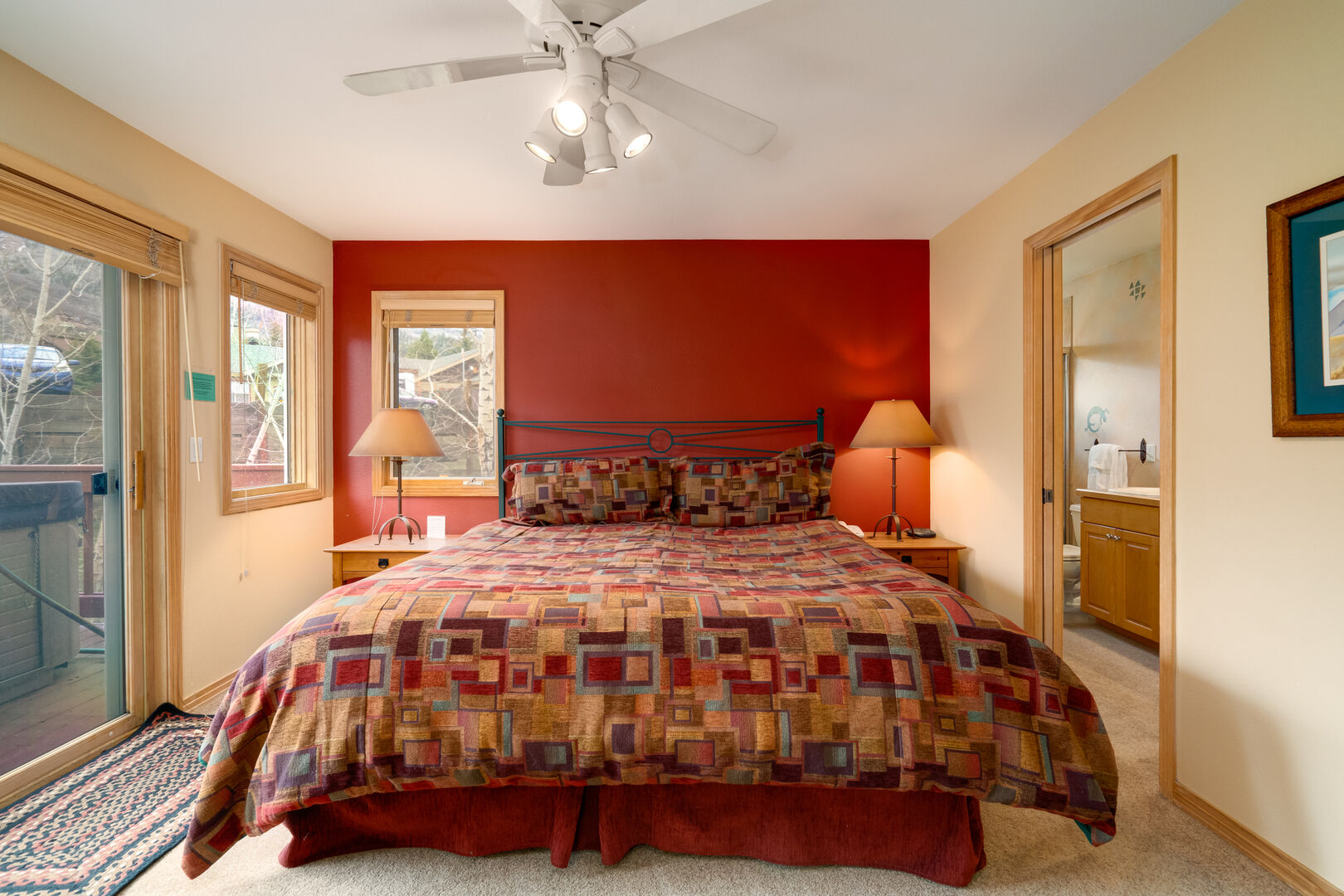 First floor master king bedroom with en suite bathroom and sliding door to the hot tub!