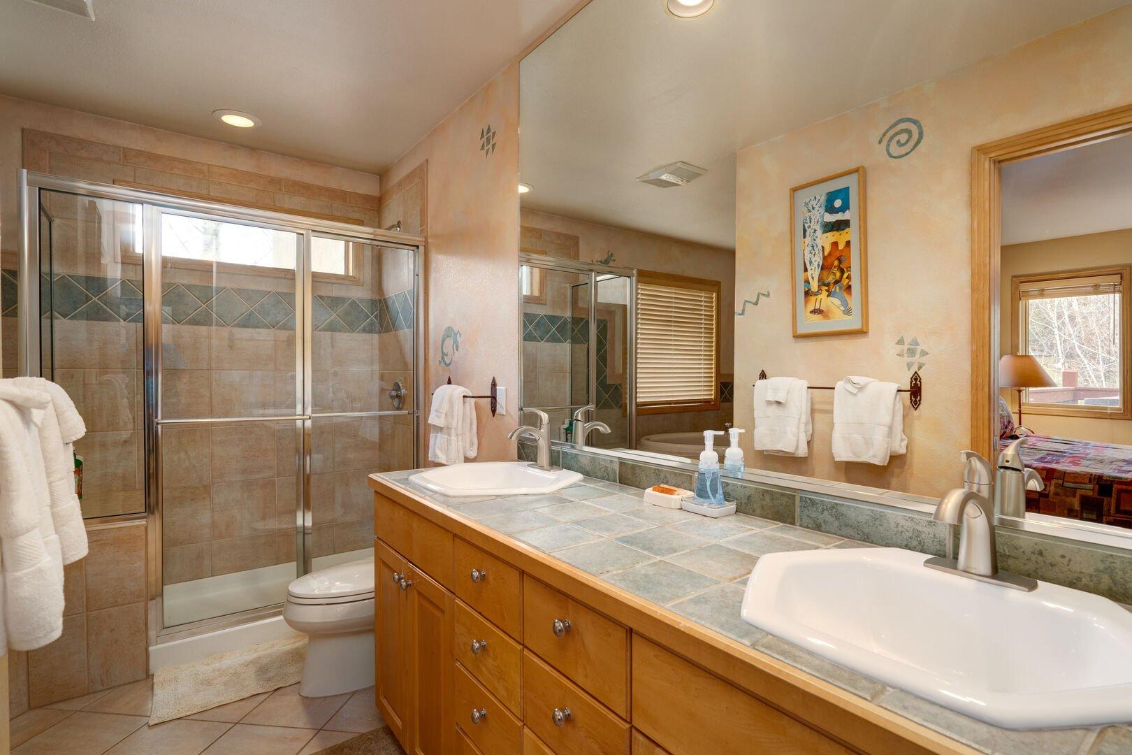 Master bath with double vanities, standing shower.