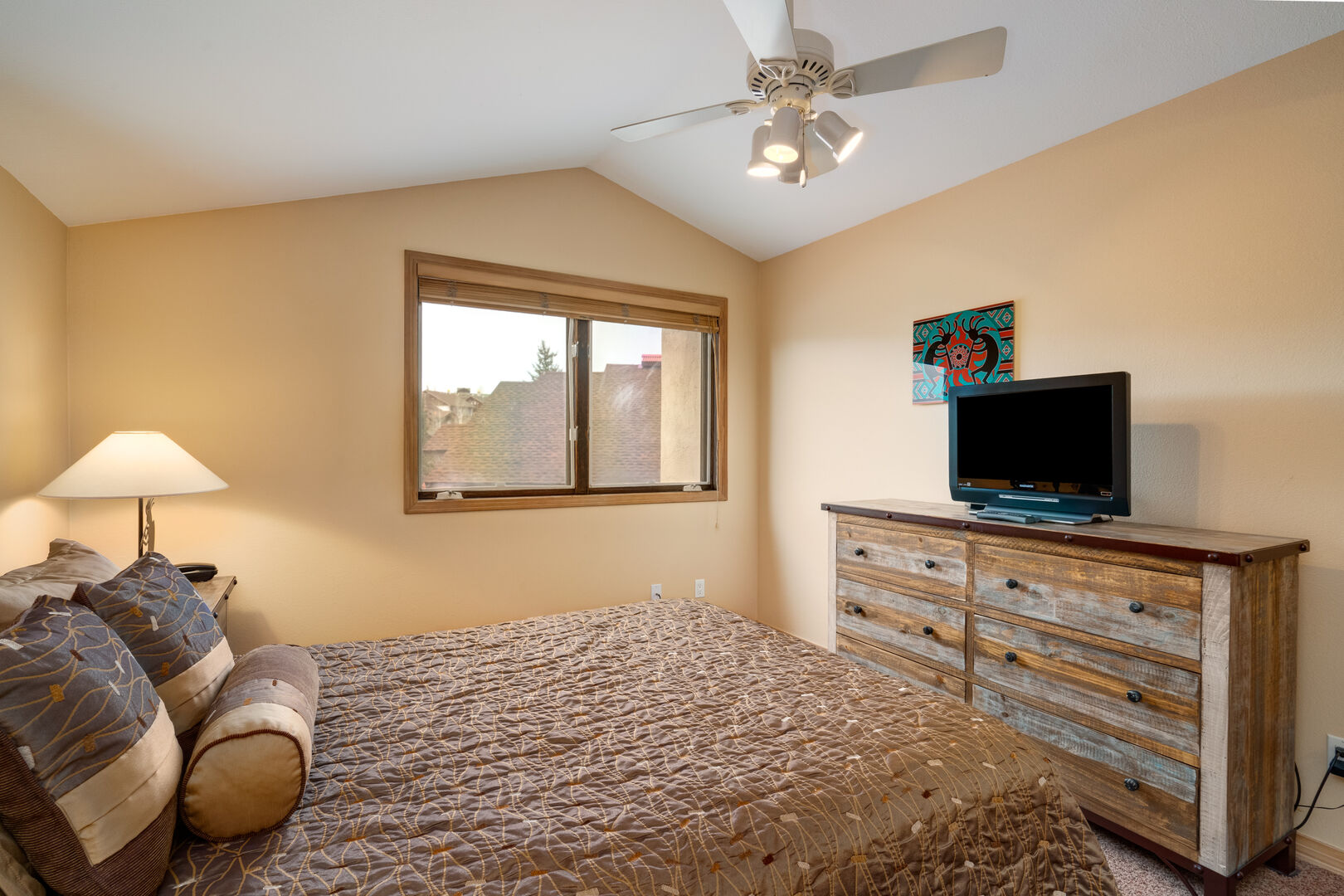 New furniture throughout the queen bedroom.