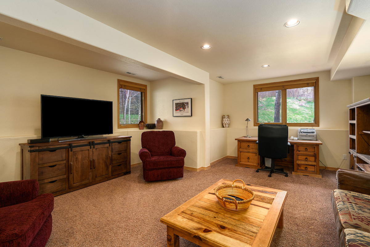 Plenty of room in the downstairs living room for TV time, games and hanging out!