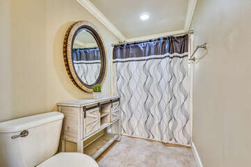 Master bathroom, tub/shower combo.