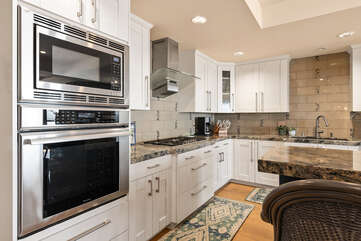 Spacious kitchen with all stainless steel appliances.