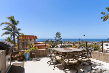 Large patio with built in BBQ and fire pit table, overlooking this beautiful view of the ocean.