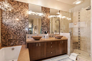 The master bathroom has a soaking tub and large shower.