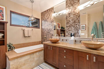 The master bathroom featuring two sinks and plenty of room to move around.