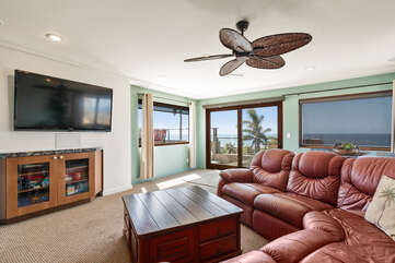 On the upper floor is a TV room with large sectional and amazing ocean views.