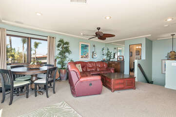 There is a small dining table and plenty of seating on this upper level of the home.