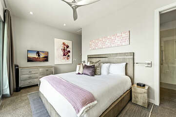 Fleur Suite with large bed, nightstands, and dresser.
