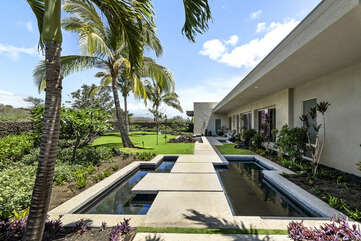 Personal pond on the walkway into this Mauna Kea house rental.