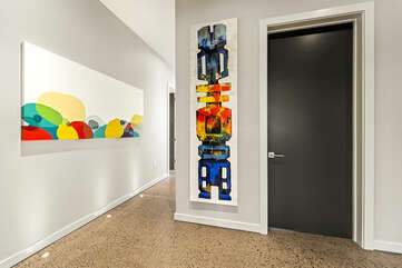 COlorful paintings hang in the spa room.