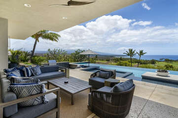Lanai by the pool with ample seating and table.