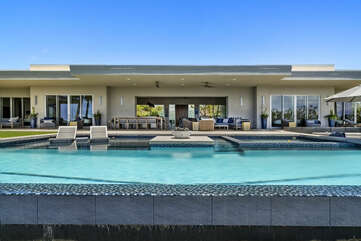 The back exterior of this Mauna Kea house rental with the pool.