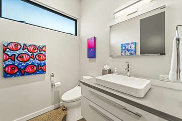 Powder Room with vanity sink and toilet.