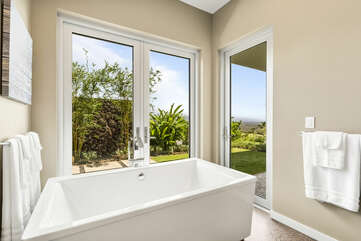 Pu'uku Ala Spa - two-person soaker tub with views from the nearby glass doors.