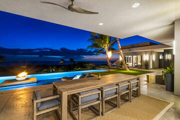 Tiki torches and fire feature light up the back lanai with table and seating for 6-8.