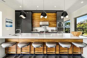 Kitchen with breakfast bar seating for 6.