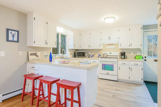 Enter from the side door into the Large kitchen with breakfast bar seating 3 -46 Har-Wood Ave Harwich- Cape Cod- New England Vacation Rentals