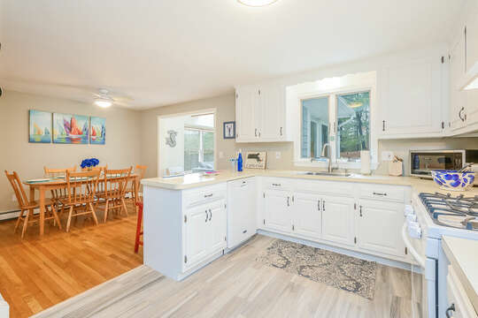 Open Kitchen, dishwasher, gas stove and microwave and dining area-46 Har-Wood Ave Harwich- Cape Cod- New England Vacation Rentals